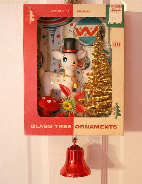 Cute idea to use vintage ornament boxes and toys to create a neat decoration for Christmas!