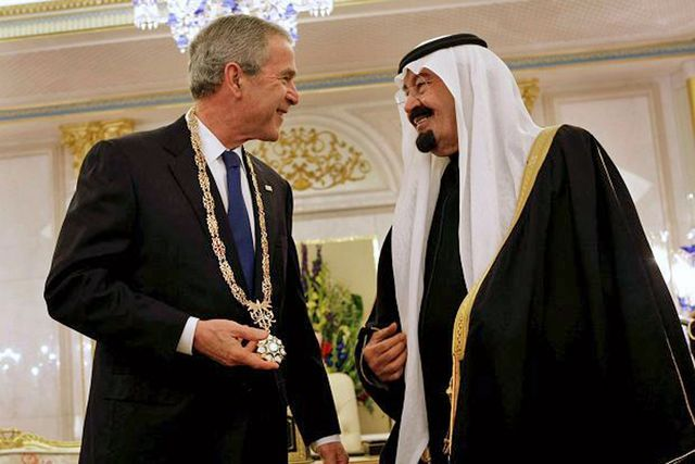 GWB with KSA King Abdullah -- Saudi Arabia sponsored and funded 9-11 attackers; George W. Bush knew and kept it secret
