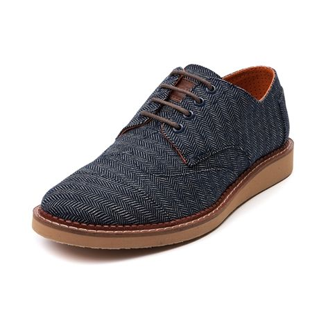 Shop for Mens TOMS Brogue Casual Shoe in Navy Denim at Journeys Shoes. Shop today for the hottest brands in mens shoes and womens shoes at Journeys.com.TOMS puts a unique spin on the classic brogue, blending casual style with traditional dress shoe refinement. This TOMS Brogue oxford shoe features a navy denim upper, classic wingtip stitching, leather welt construction, TOMS signature toe stitch, elastic straps for lace-less loafing, and cushioned perforated insole for added breathability…