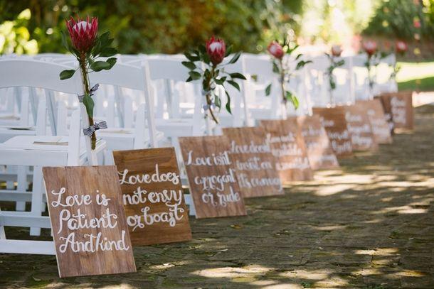 1 Corinthians aisle decoration | SouthBound Bride www.southboundbride.com Credit: Lad & Lass
