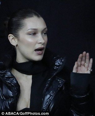 Stop right now, thank you very much: Bella looked a little like Victoria in her Spice Girls days with her black padded jacket, slicked back hair and hand gestures