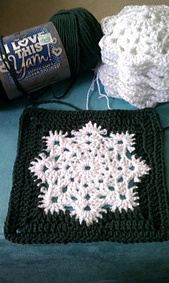 Snowflake Granny Square Afghan by Joanne Kundra.  Published in Mountain Rose