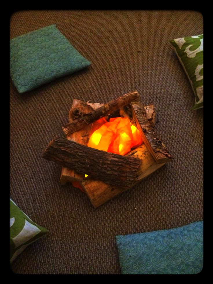 I need this fire for my daughters indoor camping party. Real logs are nestled around fake candles covered with orange tissue paper.