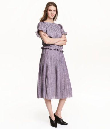 Pink/glittery. Knee-length, gently flared, pleated skirt in fine-knit fabric with glittery threads. Visible elastic at waist. Unlined.
