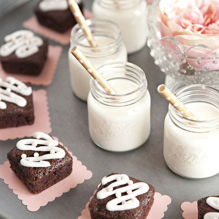 """Mini Milk Shots  Mini Brownies... we think you should totally have these passed late night at your wedding!  Search """"mini-brownies"""" on SomethingTurquoise.com to find out how you can DIY this set up!  #afternoonarchive #minimilkshots #minibrownies #weddingdessert #latenightsnack #diyweddingideas #weddingsweets"""