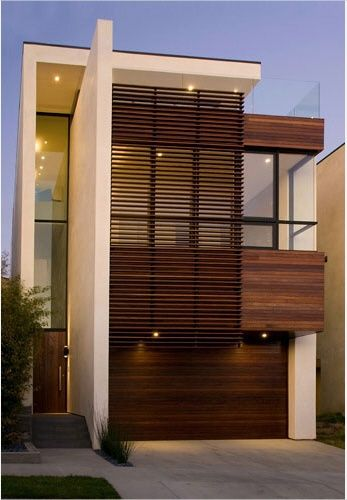The combination of wood, concrete and glass on this house works so well together.