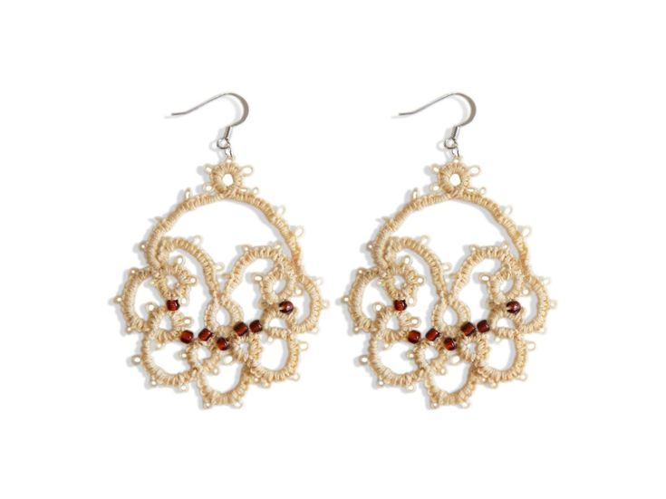 Handmade tatting earrings with a special glue for greater strength in beige color combined with brown beads approximately 2 mm each.