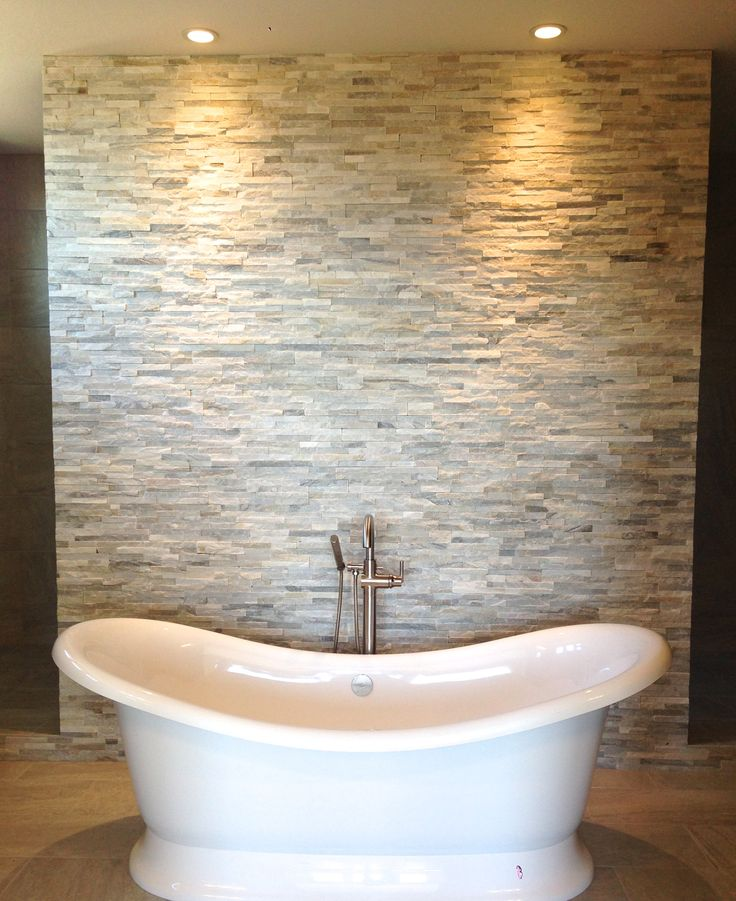 Free standing tub. Stacked stone wall. Walk through shower. (Chandelier to come..)