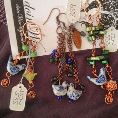 doinWire Copper bird earrings. Pairs of bird nest/eggs and bird.
