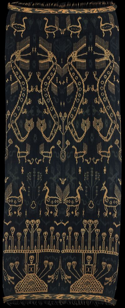 Ikat from East Sumba, IndonesiaHinggi kawuru (pahudur). 'Blue Sumba' (handspun). Named not after largest motif, but after most important: andung (skull tree). Large naga (dragons), ayam (cocks), buaya (crocodiles). Pagi-sore: top and bottom different.