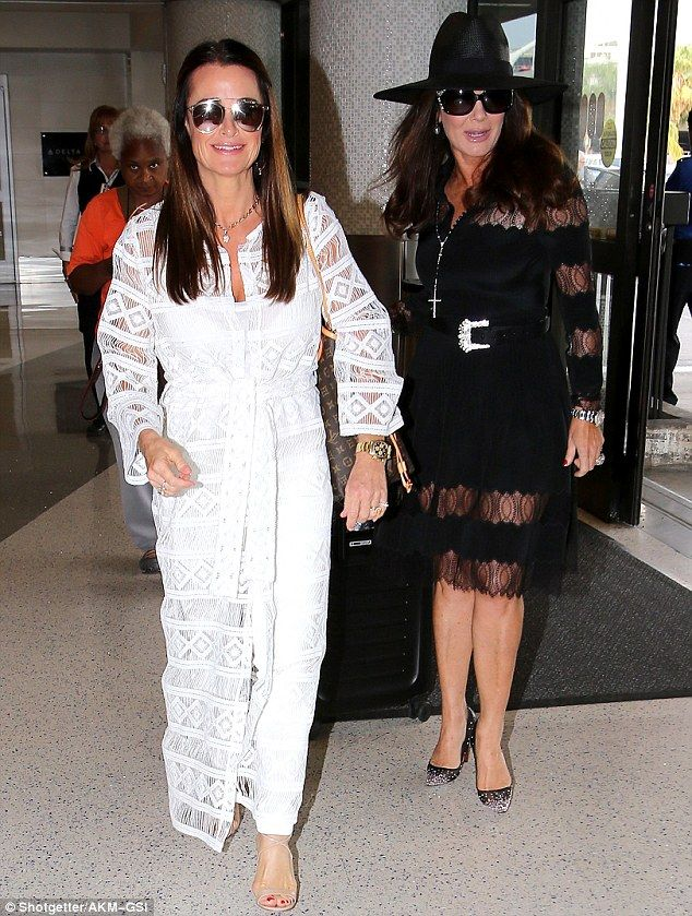 Flight fashion: Kyle Richards and Lisa Vanderpump were spotted looking ultra glamorous at LAX Airport in Los Angeles on Friday before their flight out of town