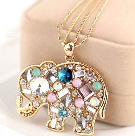 """Baby Elephant Pendant Elaborated with Colourful Stones on a Dual Chain Product ID               : N0013 Main Colour             : Gold Available Colours      : Gold Price                       : CAD 10.90 Style                       : Chain with Pendant Metal Type              : Zinc Alloy Main Stone              : Crystal Necklace Length       : 28"""""""