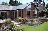 Like  seamless integration with the house and the garden.  Glass at gable end