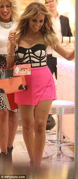 Shopaholic: Samantha struts out a store with a couple of bags on her arm during the video ...
