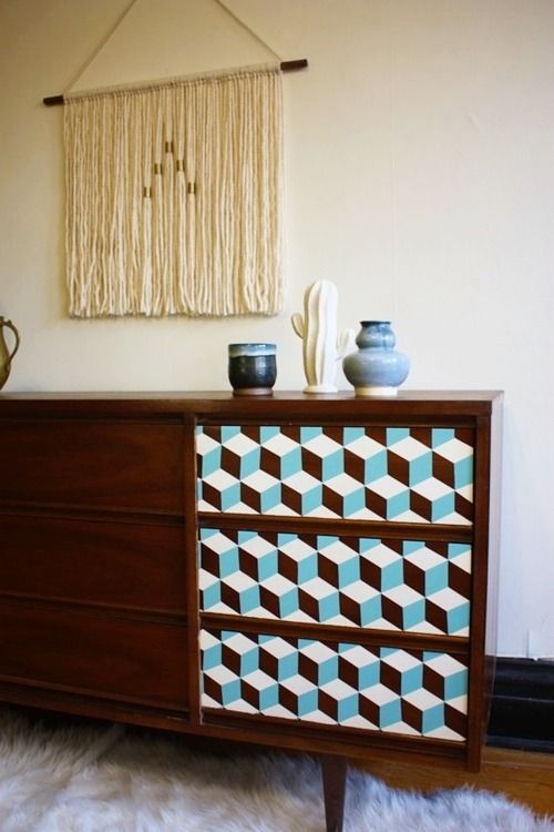 Beautifully refinished Mid-century credenza with hand painted blue and white geometric accents.