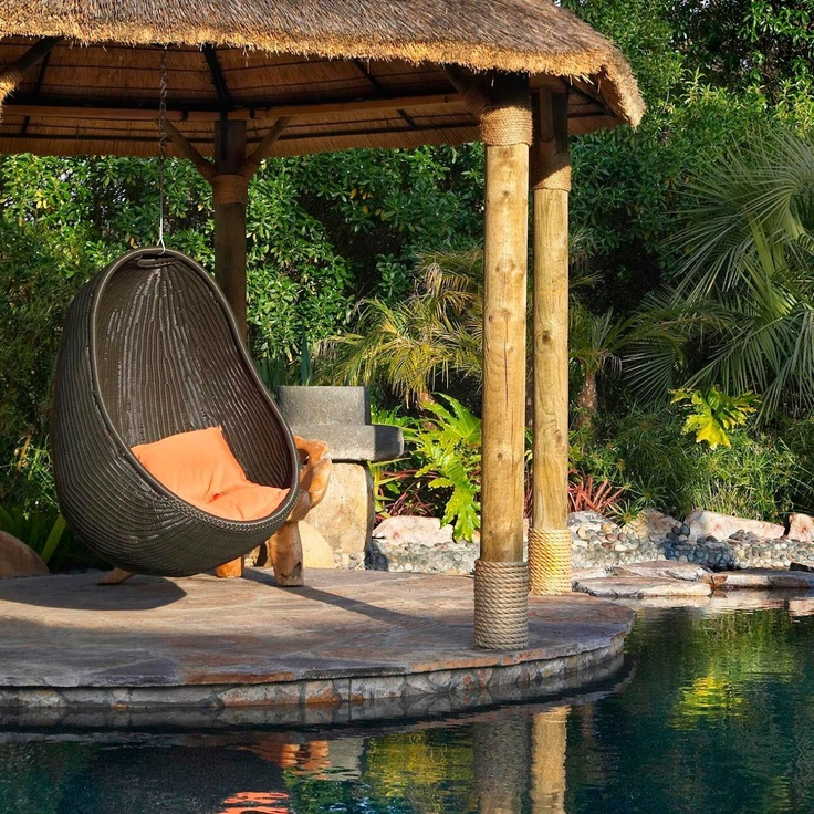 hanging wicker chair - great reading spot by the pool