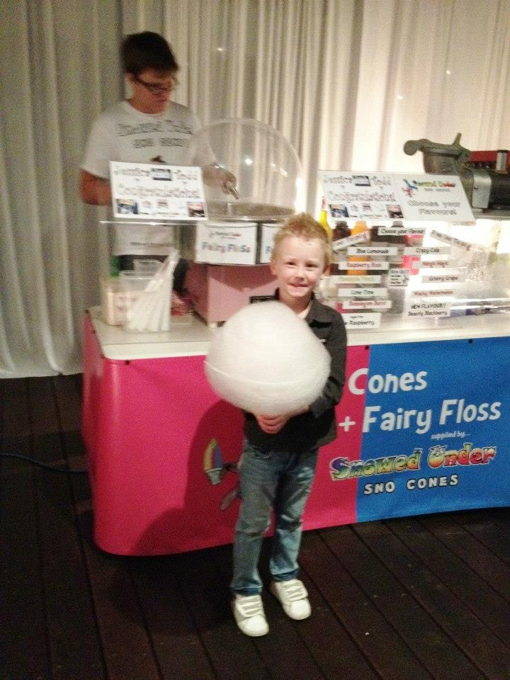 Jessica & Todd's Carnival Themed Wedding. This young chap is getting some floss to deliver to the groom, pronto.