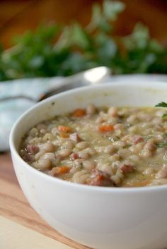 Hearty navy bean soup with ham with carrots, onion, celery, rosemary and thyme.