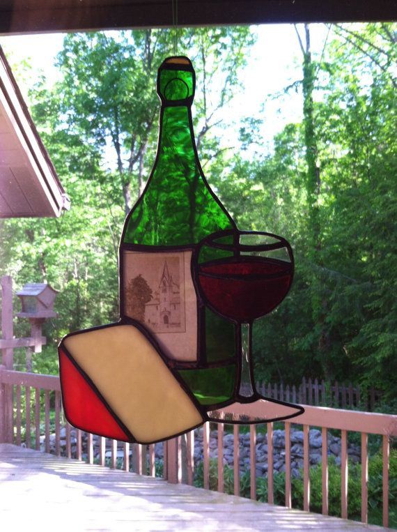 Stained Glass wine and cheese sun catcher made using a real wine label sandwiched between glass. Size is 5.25 X 8 inches. These can be personalized with your favorite wine label that you send to me. A great way to memorialize a special occasion.
