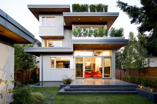Modern home with landscaped roof