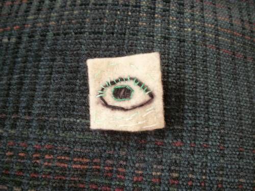 embroidery of an eye on 1x1inch felt