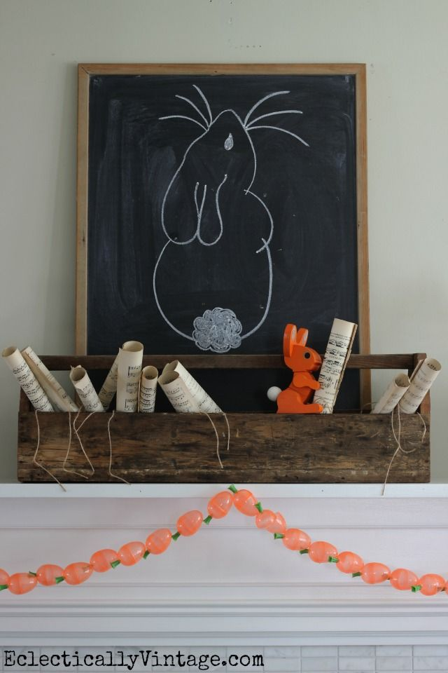 I love this spring mantel - the toolbox filled with music sheets and the adorable DIY carrot garland! eclecticallyvintage.com