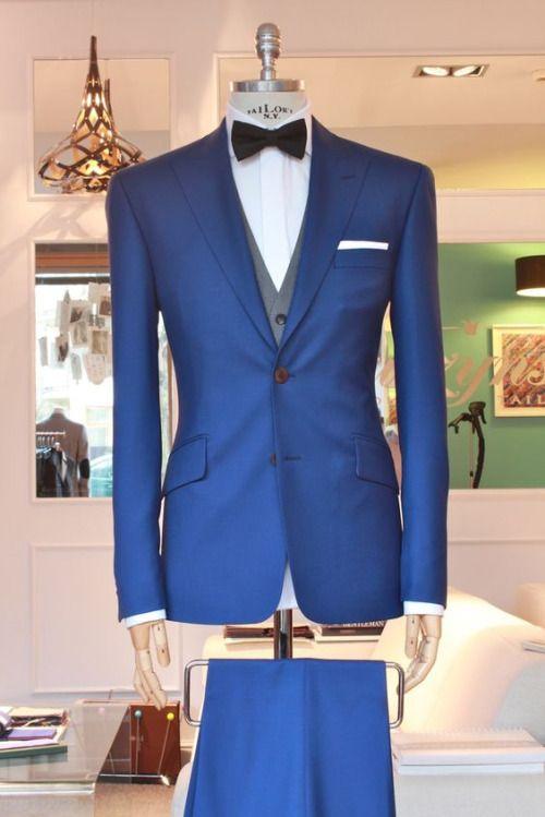 Blue suit, grey vest, black bowtie