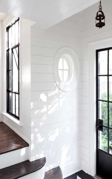 black windows in white hallway with dark floors other beautiful room designs using black as the anchor