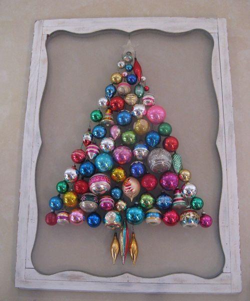 Vintage ornament tree on a repurposed screen door.