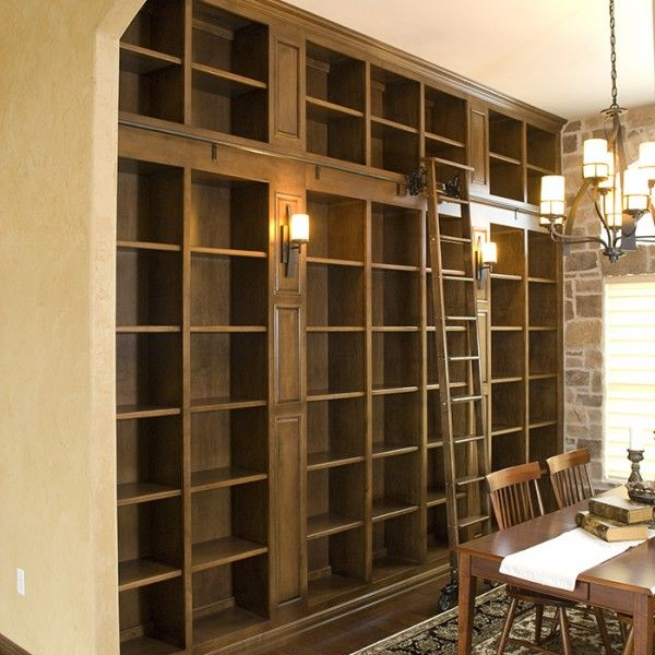 Built in bookshelves with library ladder