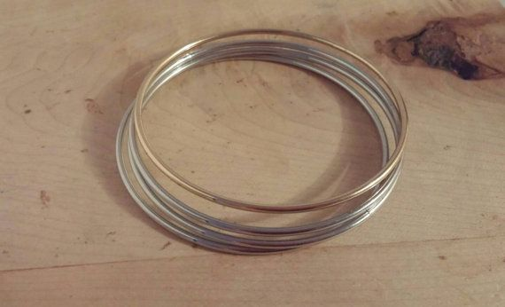 Check out this item in my Etsy shop https://www.etsy.com/ca/listing/497742699/gold-and-silver-bangle-set