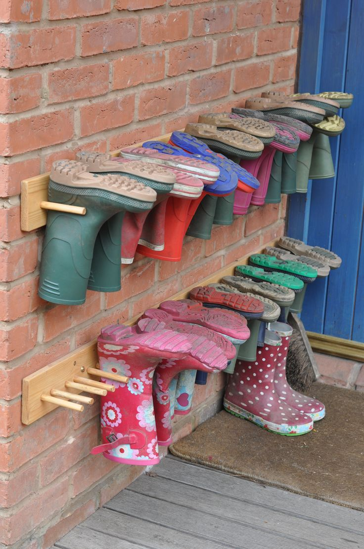 Love this idea for organizing muck boots.  That way they can stay outside and it minimizes the kinds of things that can crawl inside them!