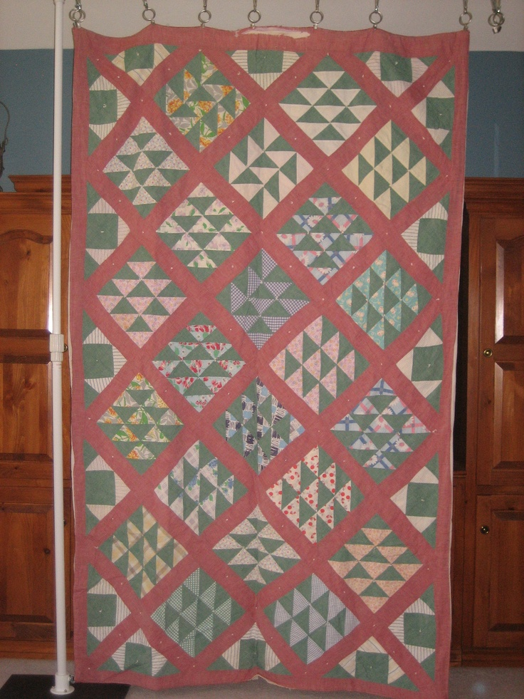 """This is an interesting quilt. It is @56""""x90"""", and has an old linen blanket as batting. Two of the blocks are in a different pattern from the others."""