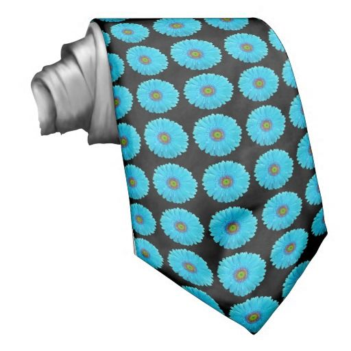 This unique, men's tie features a repeating pattern of aqua / turquoise blue gerbera daisies on a black background. This custom tie is perfect for weddings, engagement parties, proms, etc. Order for the groom, groomsmen, ushers, and fathers of the bride and groom for a fully coordinated wedding party. This same gerbera daisy pattern and colors also available in coordinating postage stamps, invitation seals, favor stickers, etc. #aqua #turquoise #tiffany #blue #black #gerbera #gerber #daisy…