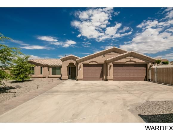 3205 Silverspoon Dr  Lake Havasu City, AZ 86406.Are you looking for Space? Then look no further as this great 3 bedroom 2 bath home with 3 car garage sits on a half acre lot with tons of room to build more garages or pool or casita! Listed by The Collins Team give us a call today 928-275-1152