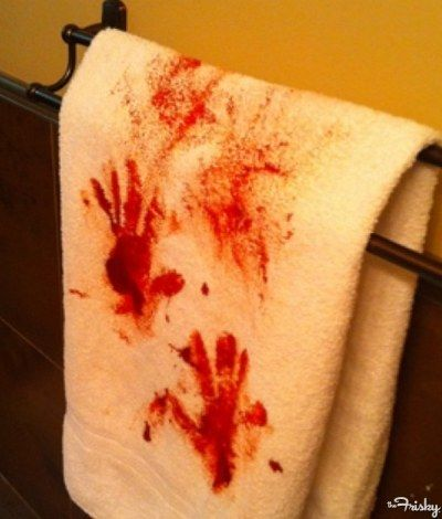 Keep the bathroom well stocked... with blood-stained towels. Some paint or food dye should do the trick. -- I'm thinking concentrated fabric dye, applied with rubber gloves.
