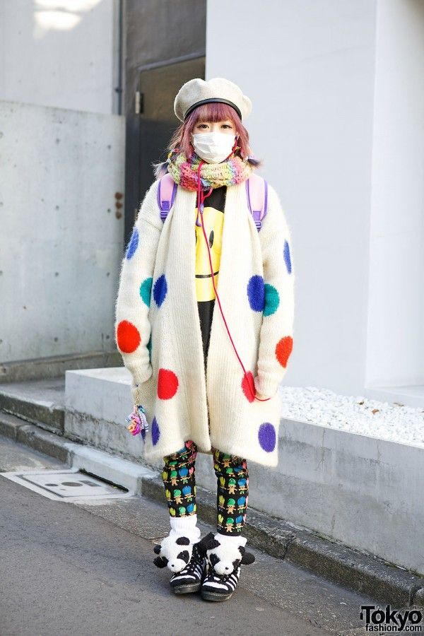 Nalumi is a friendly 19-year-old girl - and Kyary Pamyu Pamyu fan - who we met on the street in Harajuku. Her look features a resale polka dot sweater/coat over a smiley face top, Trolls leggings, colorful accessories & Panda sneakers. #tokyofashion   #streetsnaps   #Harajuku