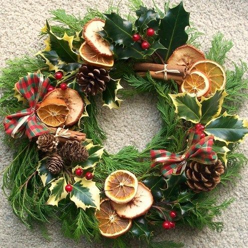 Holly wreath with dried fruit slices and cinnamon sticks. This would be pretty in the kitchen.
