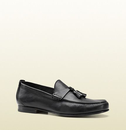 $580, Black Leather Tassel Loafers: Gucci Black Leather Loafer With Tassels. Sold by Gucci. Click for more info: https://lookastic.com/men/shop_items/424/redirect