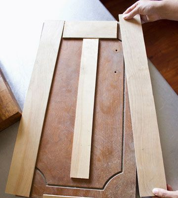 DIY Budget Kitchen Makeover- use strips of wood to reface cabinets.