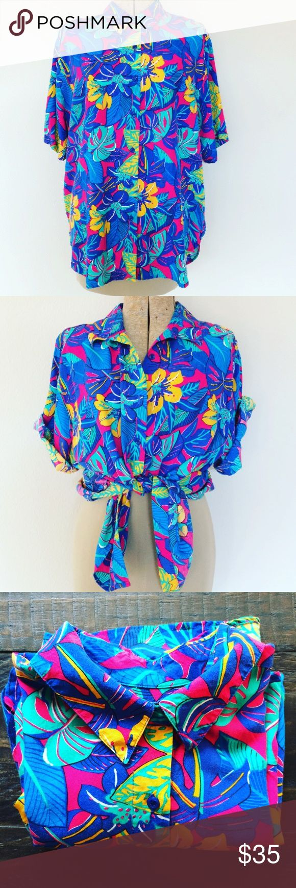 Vintage button down Blouse tropical print shirt L Vintage Pre-owned Great condition! One size fits most. Bust: 24 in Length: 27 in Tagged Large.. Brand unknown ( tag removed) 💕Wear as a blouse, belted dress or even swimsuit cover.  Bright tropical Floral print button down 100 % Rayon. 💐Super soft and flowy.  No trades. Happy poshing! TAGS # Hawaiian print island cruise vacation summer 2017 oversized top Tunic short sleeve flower leaf blue pink neon 80's 90's retro vintage Tops Button Down…