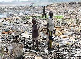 Poverty is so overwhelming that children take to the scraps after adults have picked it over. Each piece of electronic device is gone over by young kids, to ensure they have found every last bit of metal. This picture features two young boys out in a dump site, searching through electronics that were brought to their country from another part of the world.