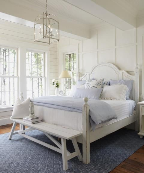 Love powder blue and white and the light openness of this room. White walls and furniture blue linens beach house decor