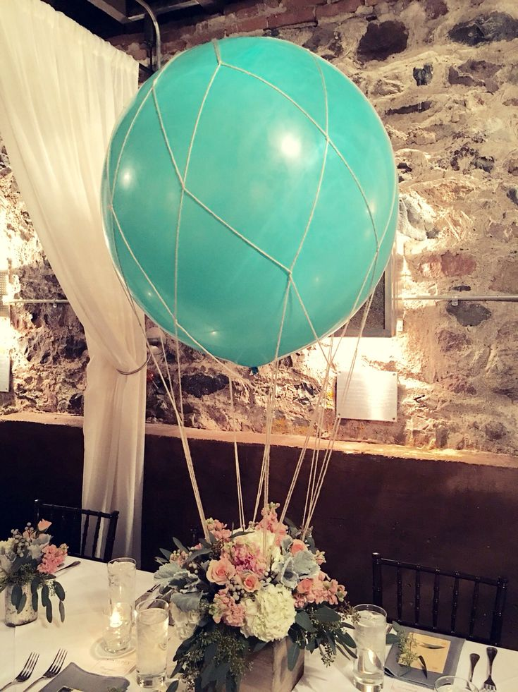 These turned out amazing! Hot air balloon centerpiece, travel inspired baby shower