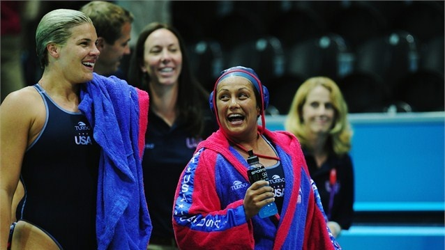 Brenda Villa of USAjokes with team mates after the women's Water Polo preliminary match between Hungary and USAon Day 3 of the London 2012 Olympic Games at AquaticsArena