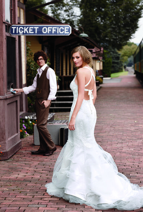 Brides.com: Romantic Lace Wedding Dresses. Book two for the sleeper car. This figure-hugging French-lace mermaid gown from Kelima K features a V-neckline bodice and a crisscross tie detail at the back.  Dress $7,775, Kelima K. Ring, Leo Ingwer. On groom: Shirt, J. Hilburn. Vest and pants, Tallia Orange. Glasses, Paul Smith; 415-352-3520. Shoes, Billy Reid.