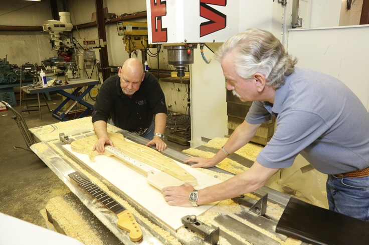Chuck Thompson and Jack Jenkins inspecting the CNC work on