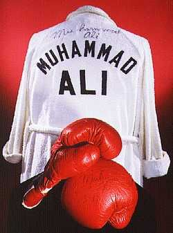 Gloves and robe worn by Muhammad Ali, three-time heavyweight boxing champion, about 1975