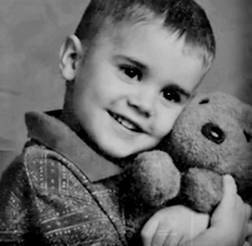 Justin Bieber as a kid. omg he is the cutest baby EVER AWWWWW <3