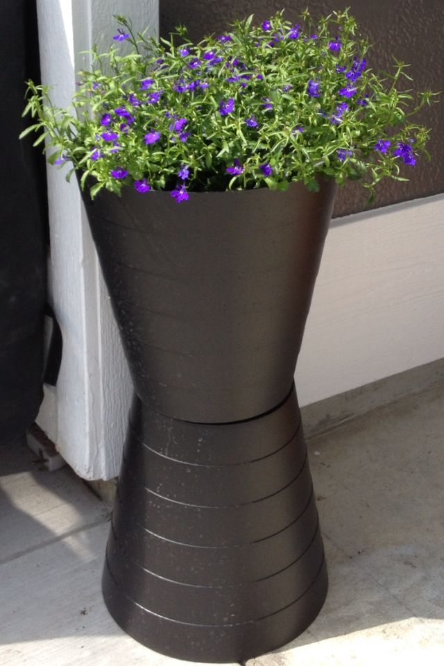DIY Instant modern planters made out of 2 Ikea $1.99 trash cans. Just screw them together with a nut and bolt.